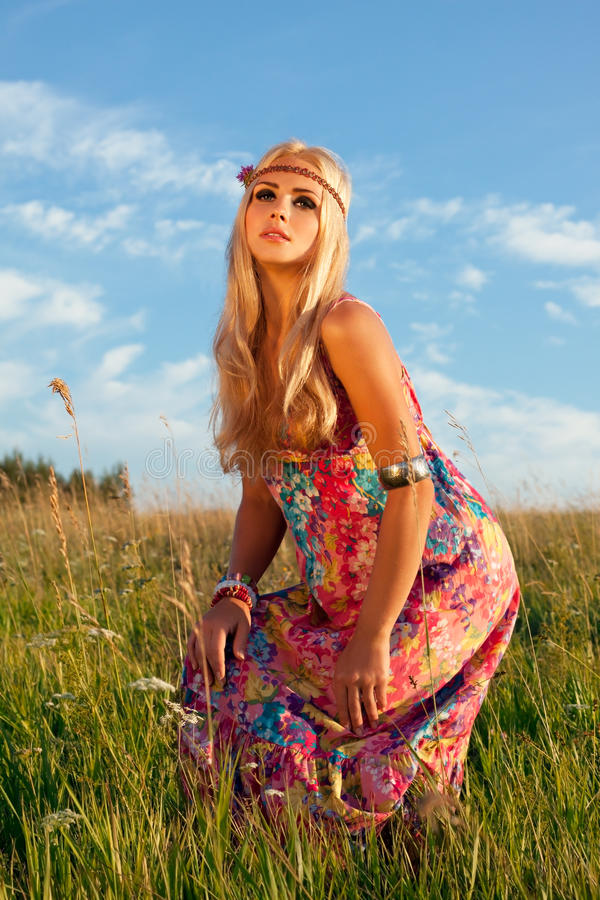 Download Beautiful Blond Posing In Meadow Against Blue Sky Stock Image - Image: 26006723