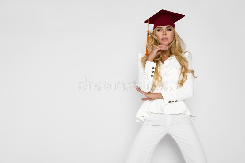Beautiful student is finishing her studies. Discharge of a beautiful woman. Beautiful blond student is finishing her studies. Discharge of a beautiful woman stock image