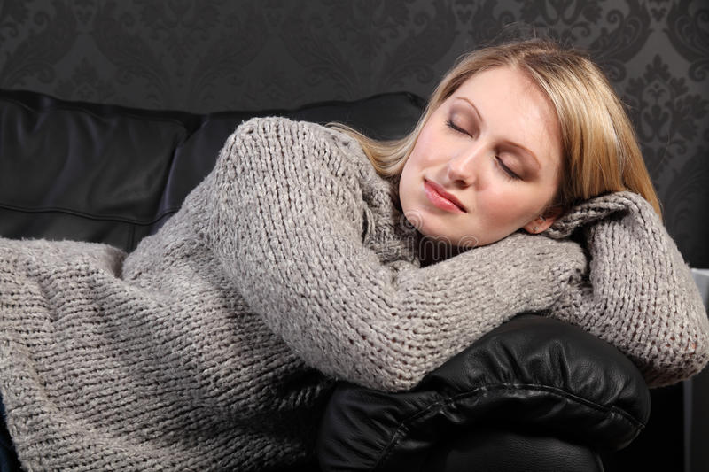 Download Beautiful Blond Woman Asleep In Grey Knit Sweater Stock Photo - Image of black, chill: 19545596