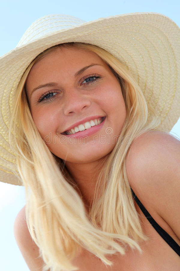 Beautiful blond woman at the beach stock photos