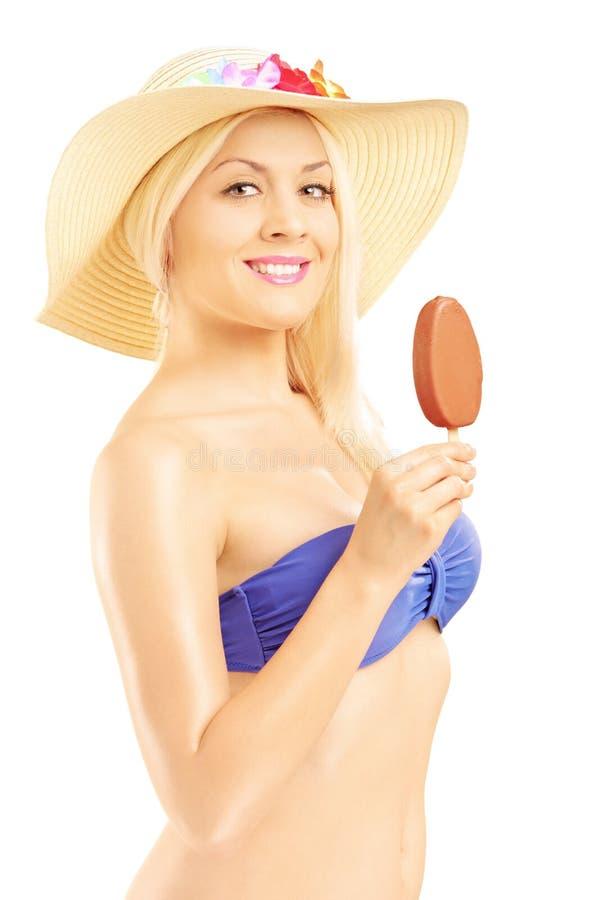 Beautiful Blond Woman In Bikini Eating An Ice Cream Stock Images