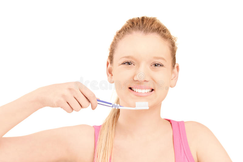 Download A Beautiful Blond Woman Brushing Her Teeth Stock Image - Image: 28605775