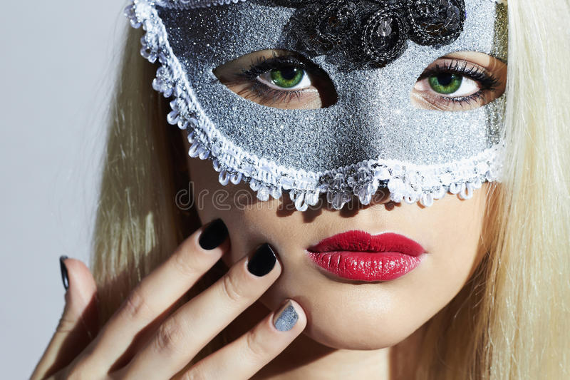 Beautiful Blond Woman in Carnival Mask.Masquerade. Girl. Lovely.Manicure. Nail design royalty free stock photos
