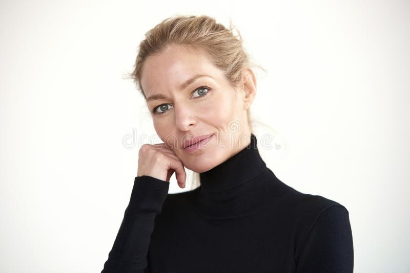Beautiful blond woman close-up portrait while looking at camera and smiling stock photography