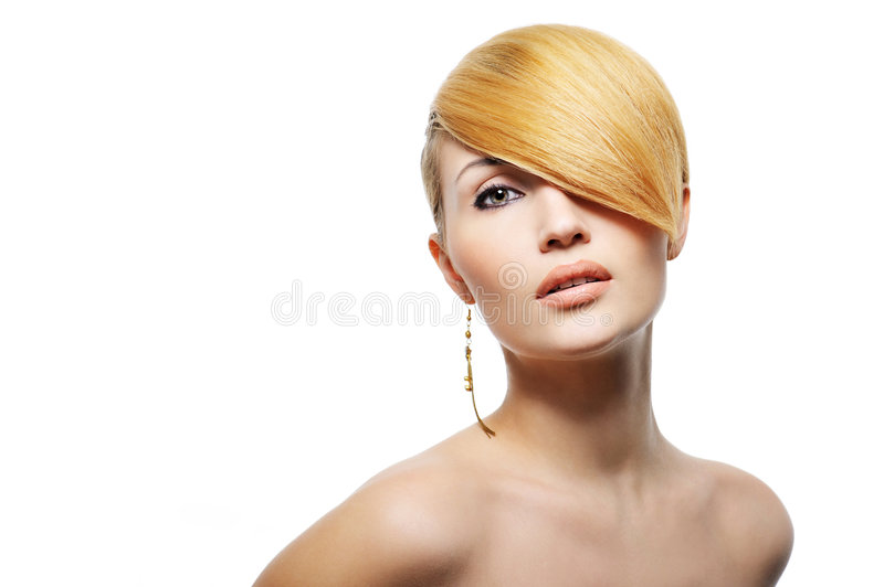 Beautiful blond woman with creative hairstyle royalty free stock photo