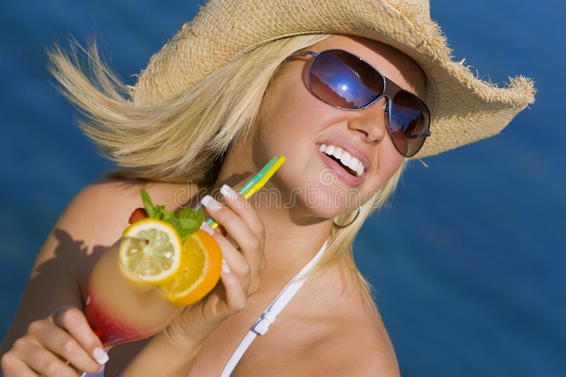 Beautiful Blond Woman Drinking Cocktail By The Sea Royalty Free Stock Photos