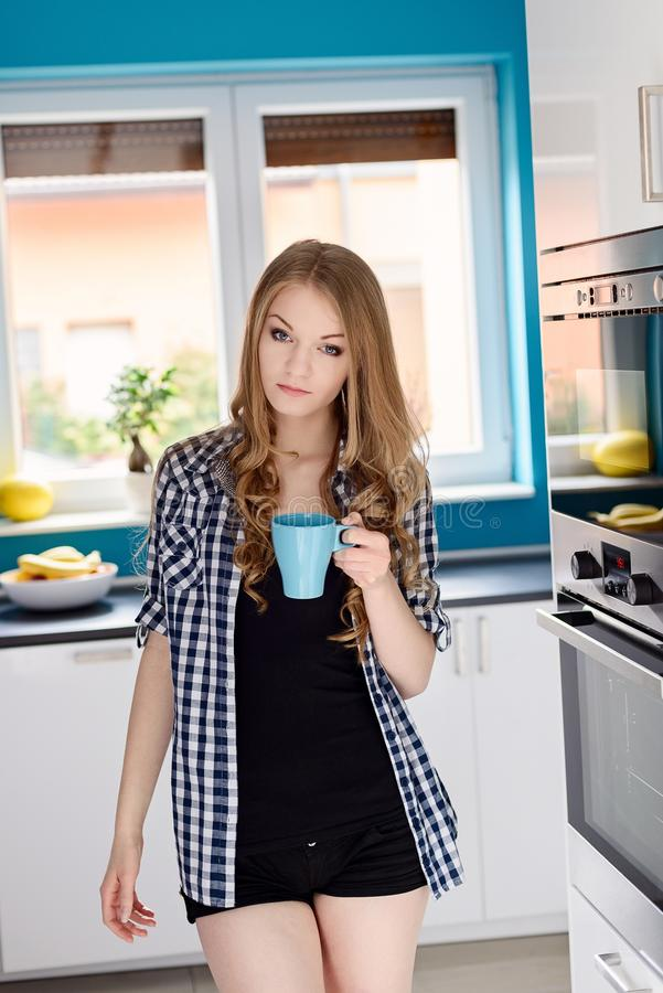 Beautiful blond woman drinking coffe or tea from the cup. stock images