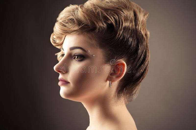 Beautiful blond woman face profile with fashionable hairstyle stock images