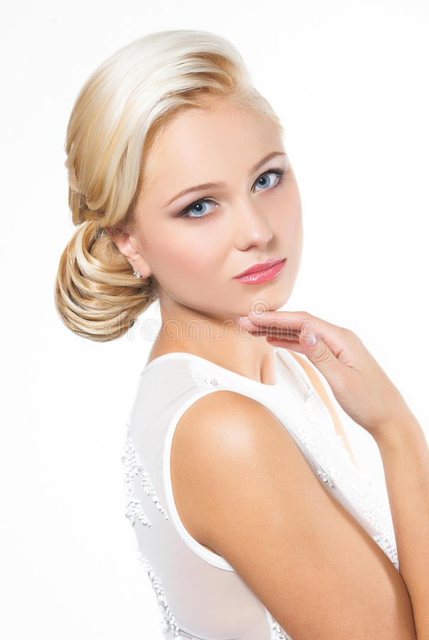 Beautiful blond woman with hairstyle stock image
