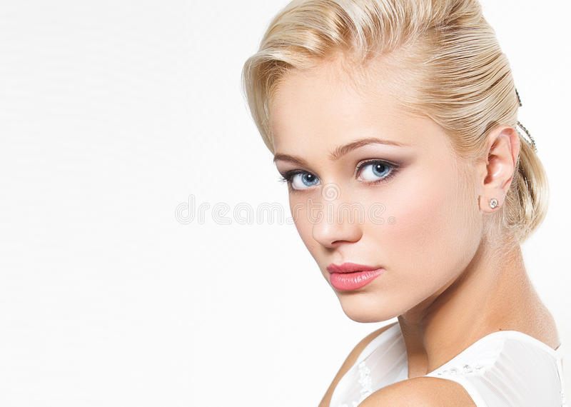 Beautiful blond woman with hairstyle royalty free stock image