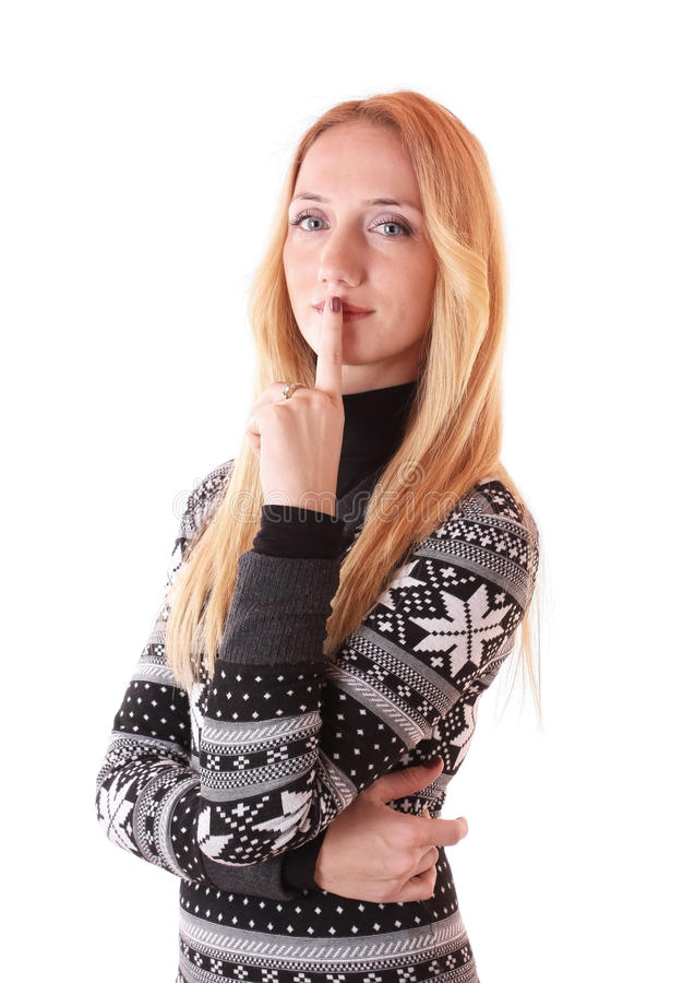Beautiful blond woman holding finger at her mouth royalty free stock photo