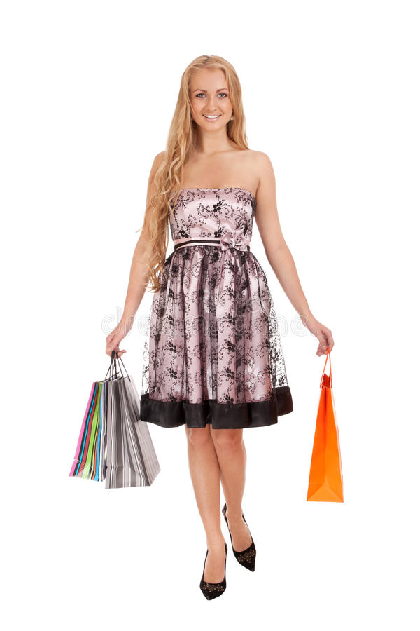 Download Beautiful Blond Woman Holding Shopping Bags Stock Photo - Image: 27748130