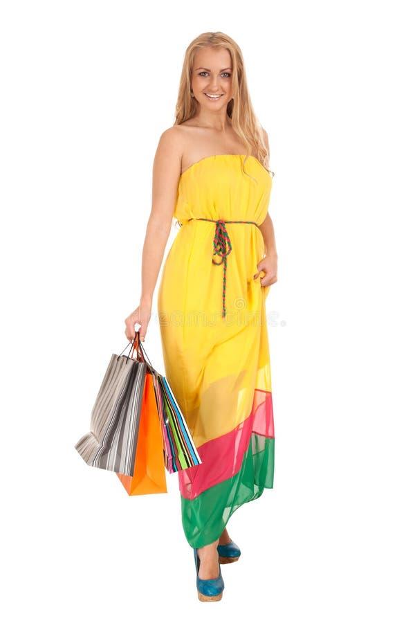 Beautiful blond woman holding shopping bags