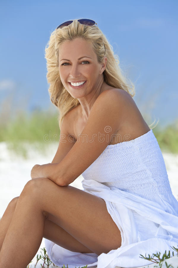 Free Beautiful Blond Woman In White Dress At Beach Royalty Free Stock Photo - 16089325