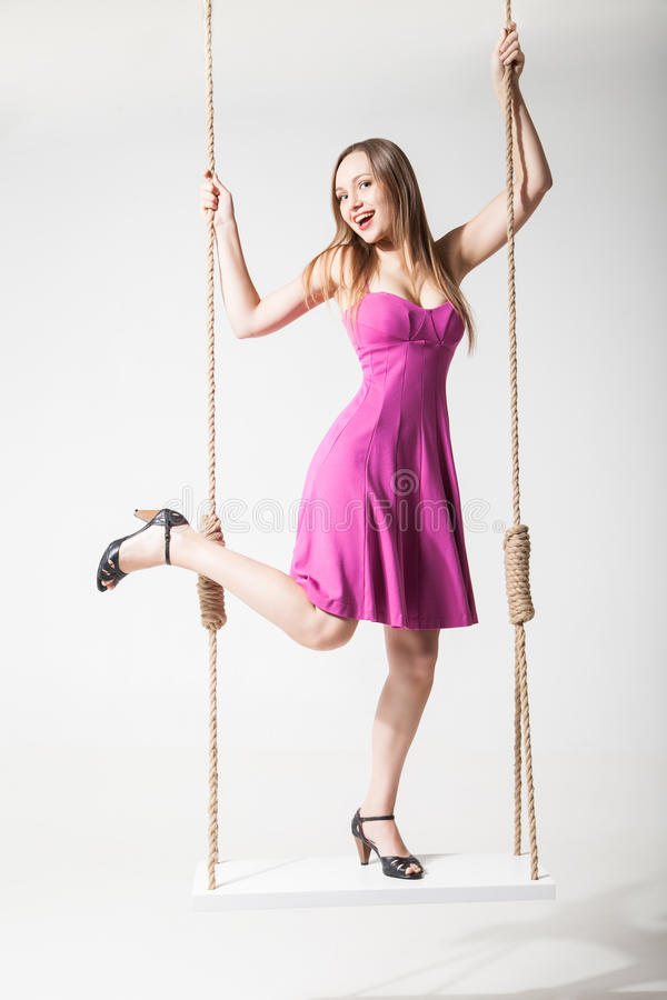 Free Beautiful Blond Woman On Swing Against White Royalty Free Stock Images - 39296309