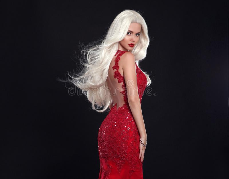 Beautiful blond woman in red dress isolated on black background. stock images