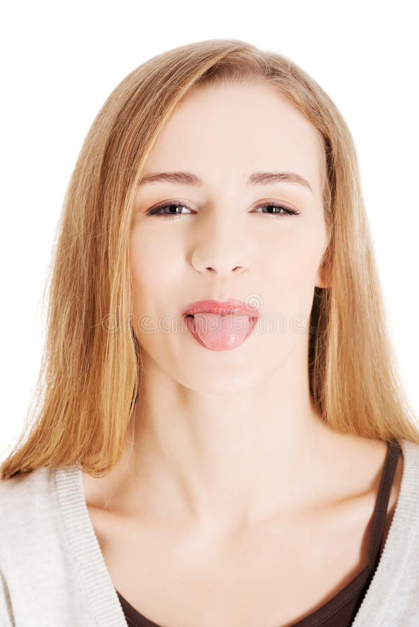 Beautiful blond woman showing her tongue. stock photo
