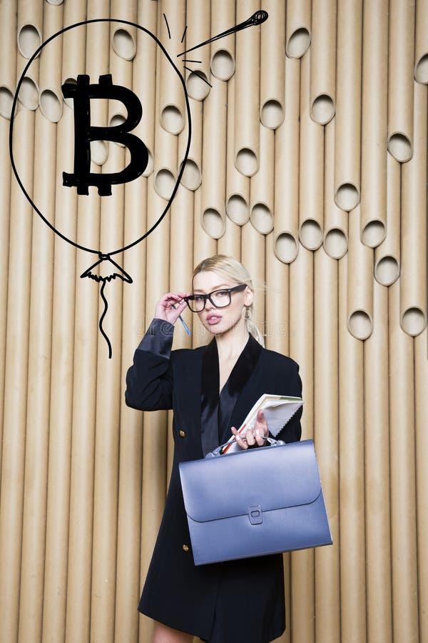 Beautiful blond woman showing standing near bitcoin sketch. Virtual money or btc crush concept. Cryptocurrency. Beautiful woman showing standing near bitcoin stock photography
