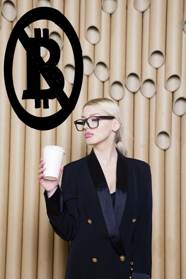 Beautiful blond woman showing standing near bitcoin sketch. Virtual money or btc crush concept. Cryptocurrency. royalty free stock photos