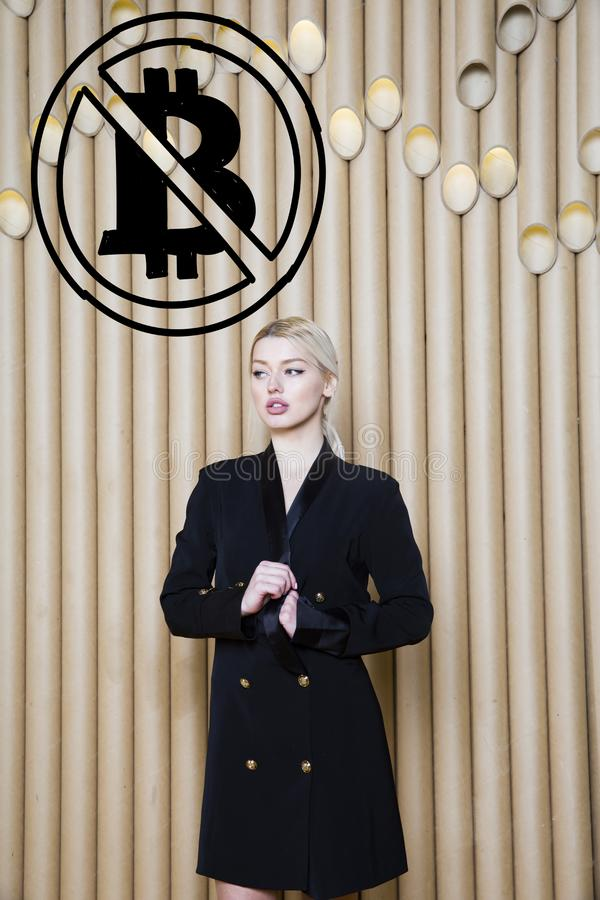 Beautiful blond woman showing standing near bitcoin sketch. Virtual money or btc crush concept. Cryptocurrency. Beautiful woman showing standing near bitcoin stock photo