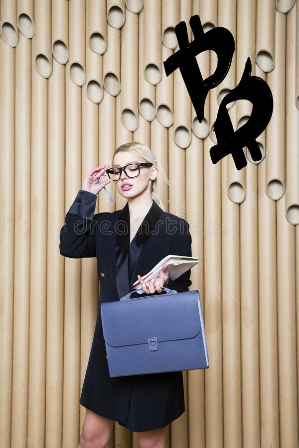 Beautiful blond woman showing standing near bitcoin sketch. Virtual money or btc crush concept. Cryptocurrency. stock photos