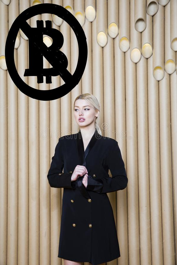 Beautiful blond woman showing standing near bitcoin sketch. Virtual money or btc crush concept. Cryptocurrency. stock images