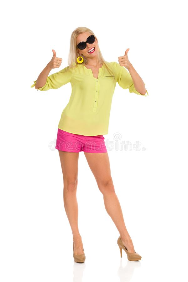 Beautiful Blond Woman Is Showing Thumbs Up royalty free stock images
