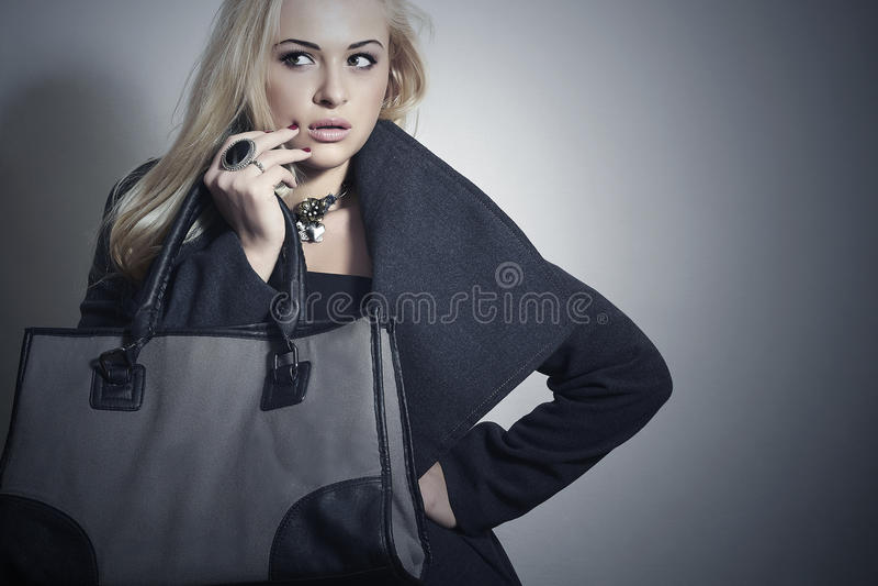 Beautiful Blond Woman in Topcoat.Girl with Handbag stock photos
