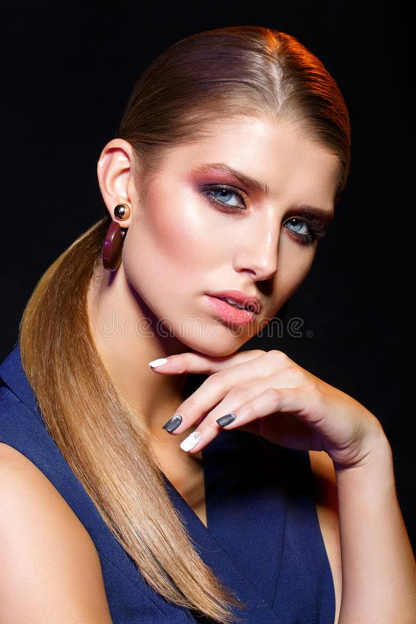 Beautiful blond girl with dark makeup royalty free stock images