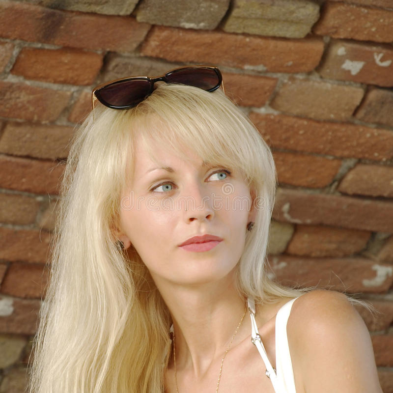 Free Beautiful Blonde Against Old Brick Wall. Stock Photos - 33509573