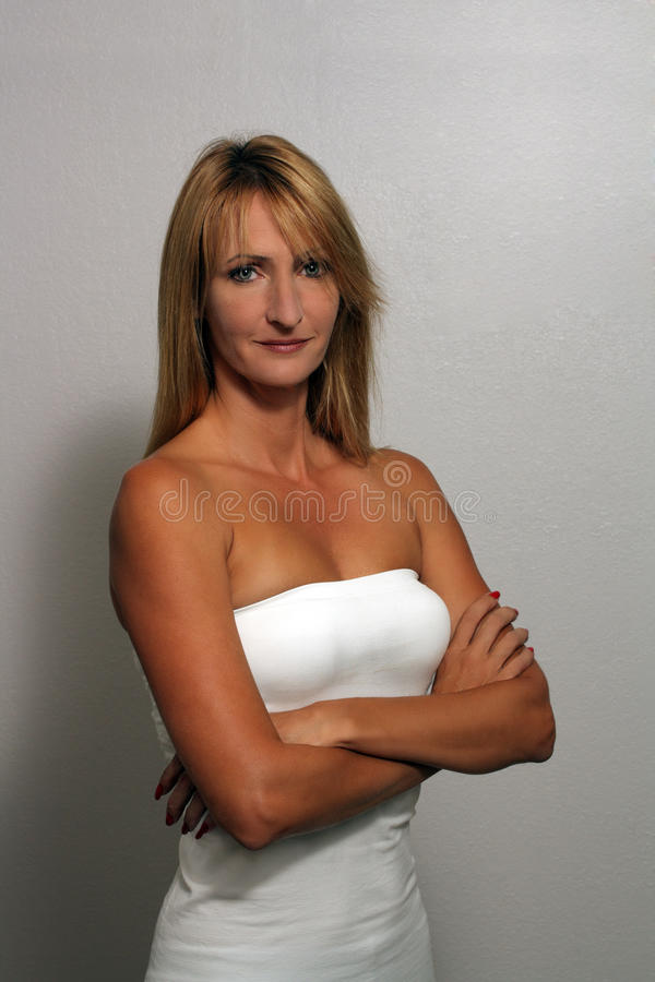 Download Beautiful Blonde With Arms Crossed Stock Photo - Image of female, lady: 20811384