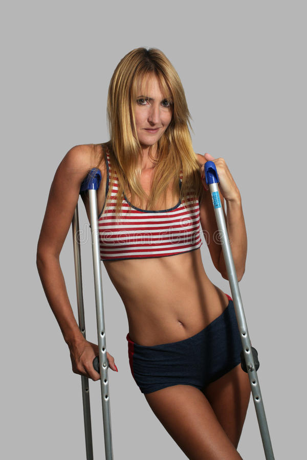 Beautiful Blonde Athlete on Crutches (1) stock photography