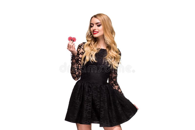 Beautiful blonde in a black dress with casino chips in hands isolated on a white background. Poker. Casino. Roulette Blackjack Spin. Caucasian young woman royalty free stock photos