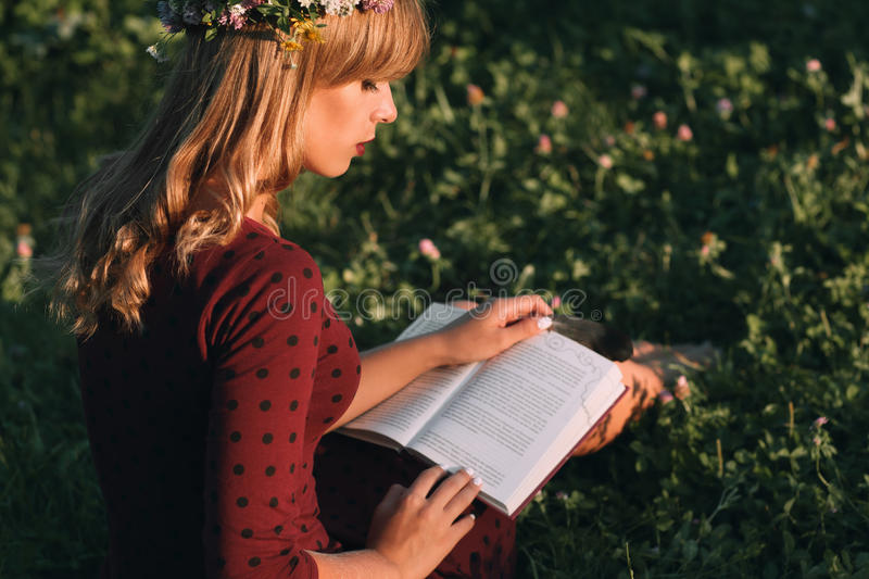Beautiful blonde with book profile, copy space royalty free stock photography