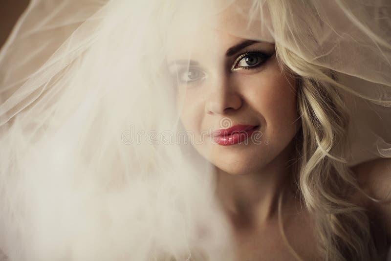 Beautiful blonde bride. daylight. studio shot royalty free stock image