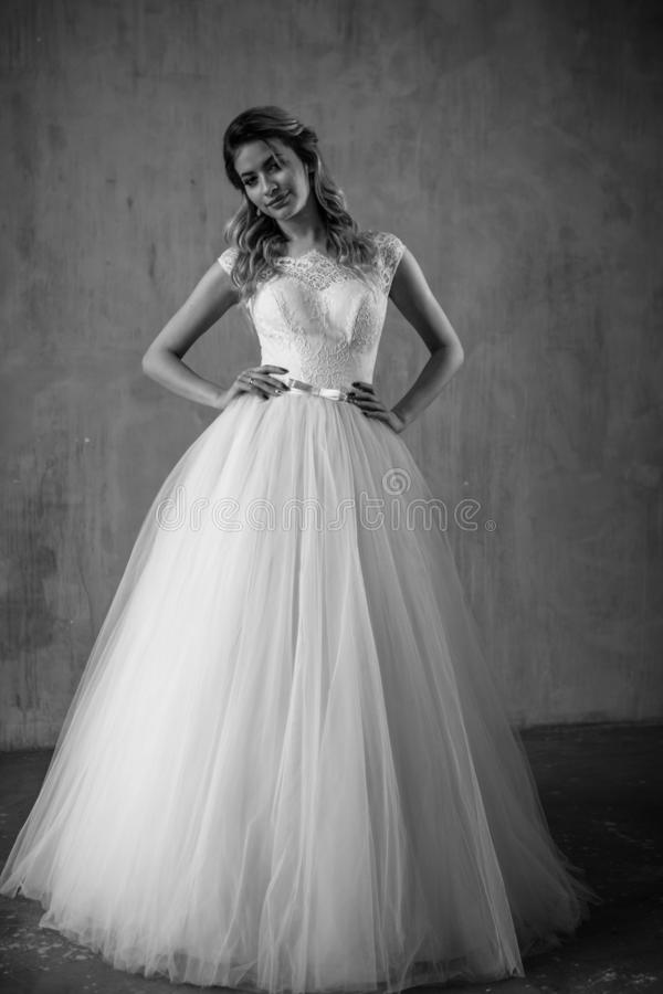 Beautiful blonde bride woman in a gorgeous wedding dress, fashion beauty portrait. In interior royalty free stock photography
