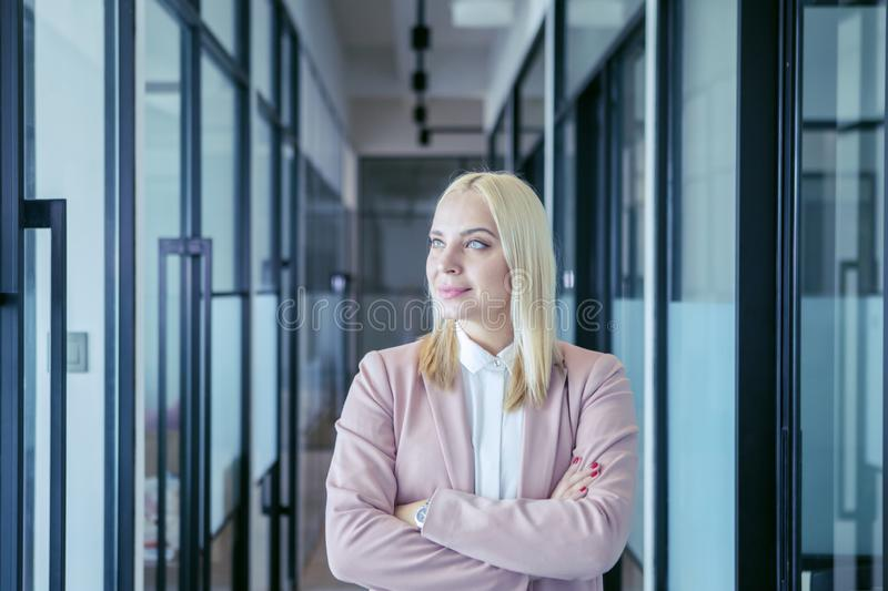 Beautiful blonde businesswoman smiling seriously stock photography
