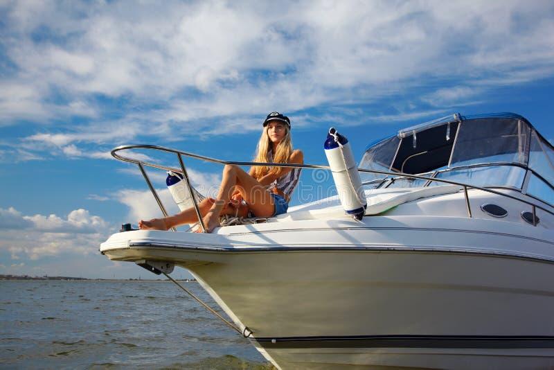Beautiful blonde captain royalty free stock image