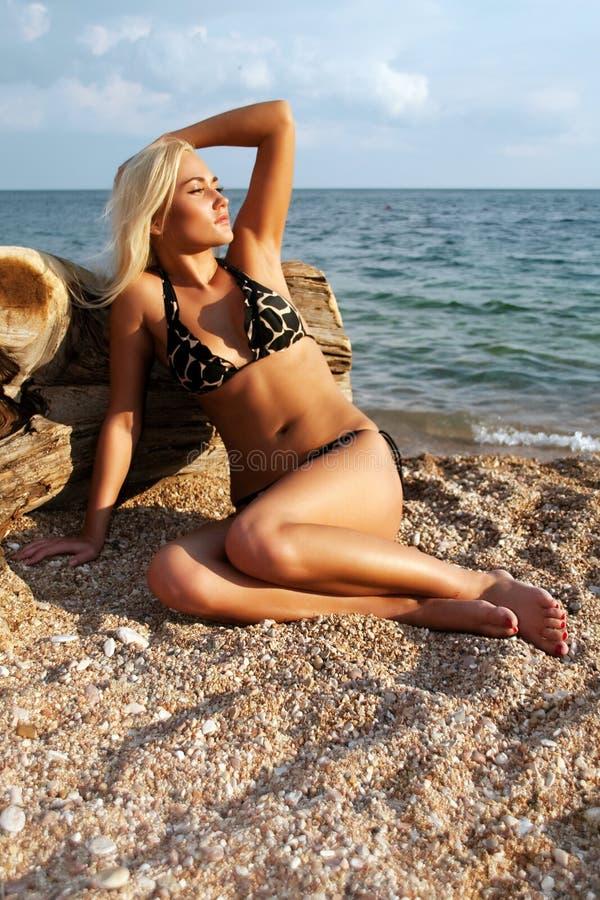 The beautiful blonde on coast of Black sea stock photos