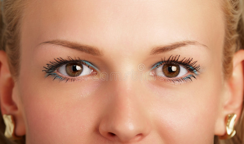Woman with brown eyes stock image