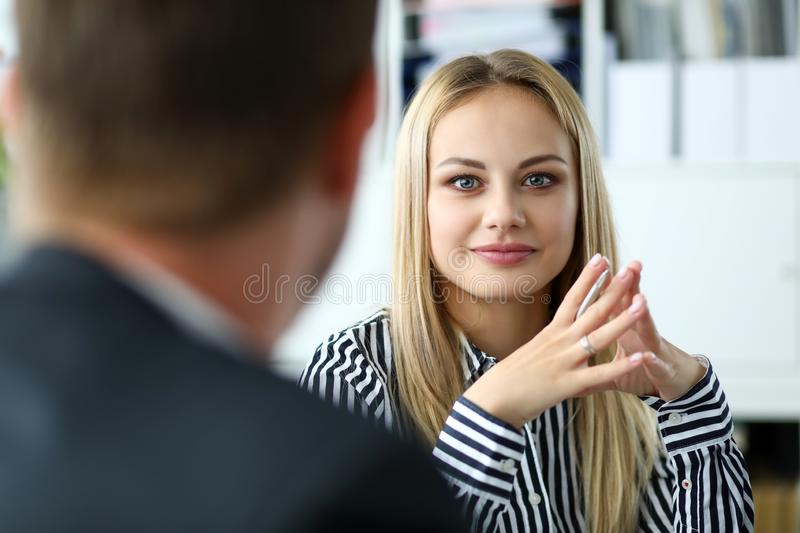 Beautiful blonde female person sitting at workplace portrait stock photo