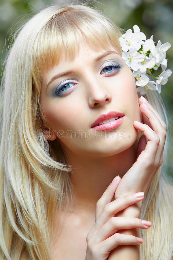 Beautiful blonde with flowers stock image