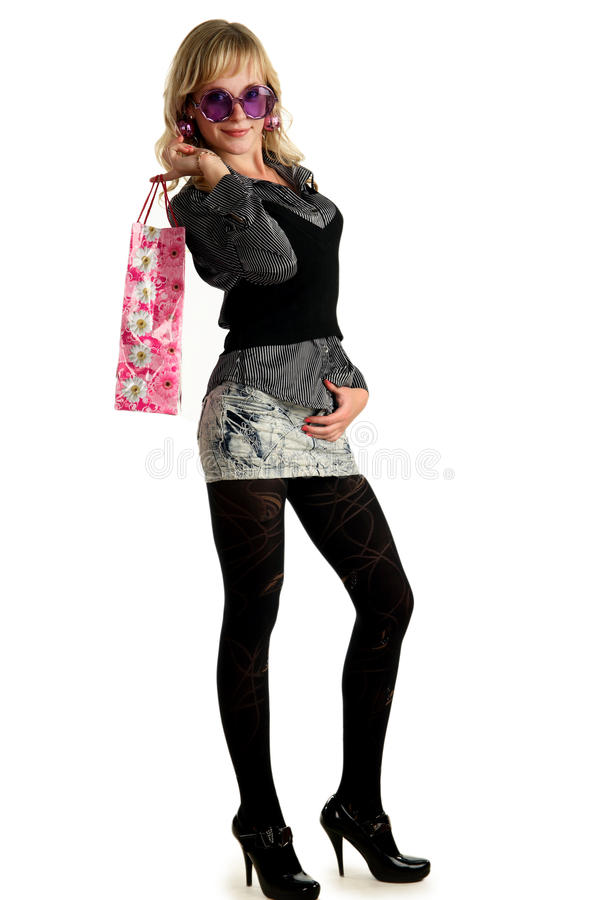 Beautiful blonde girl with a bag of shopping stock photo