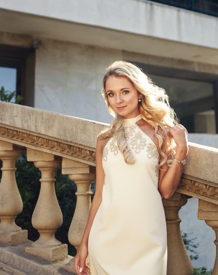 Beautiful blonde girl or bride lookind at camera stock image