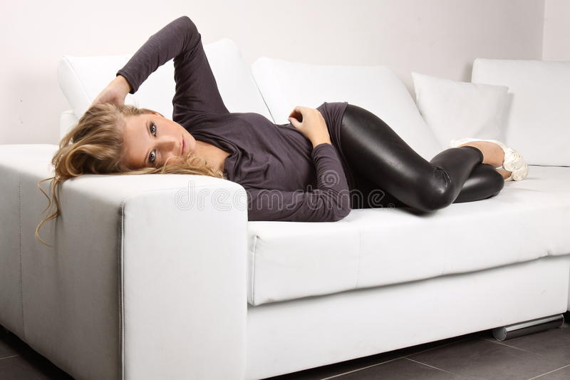 Download Beautiful Blonde Girl On The Couch Stock Image - Image: 29344427
