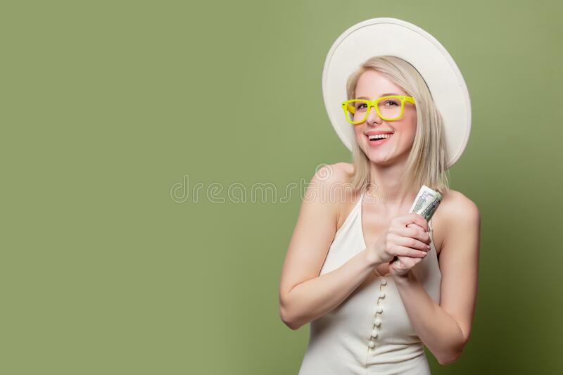 Beautiful blonde girl in glasses with money royalty free stock photography