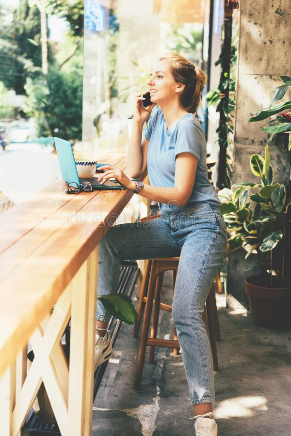 Beautiful blonde girl with a laptop in a cafe stock photo