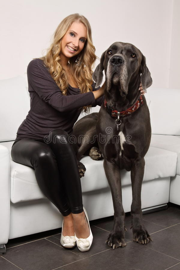 Download Beautiful Blonde Girl With A Large Dog  On The Cou Royalty Free Stock Images - Image: 29344429