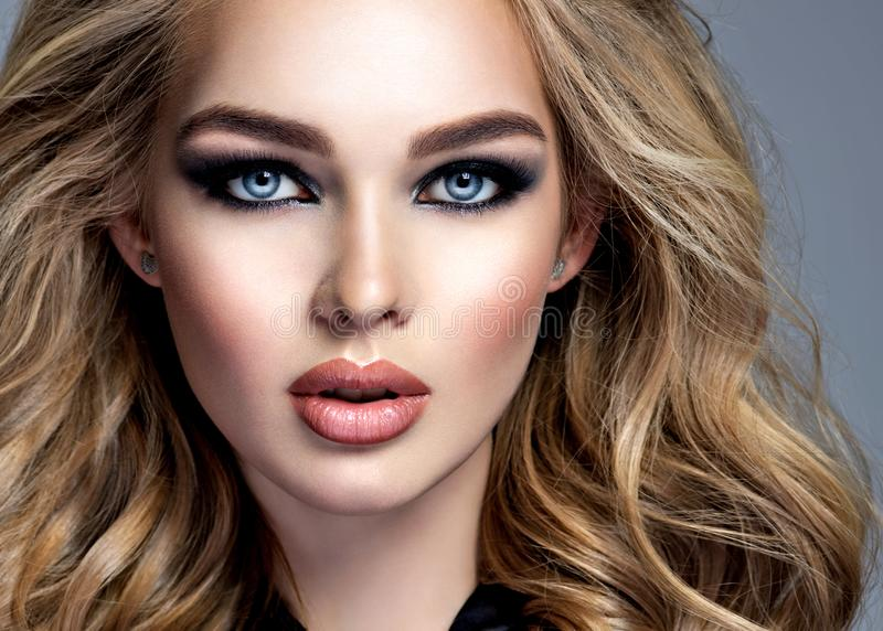 Beautiful blonde girl with  makeup in style smoky eyes stock photo