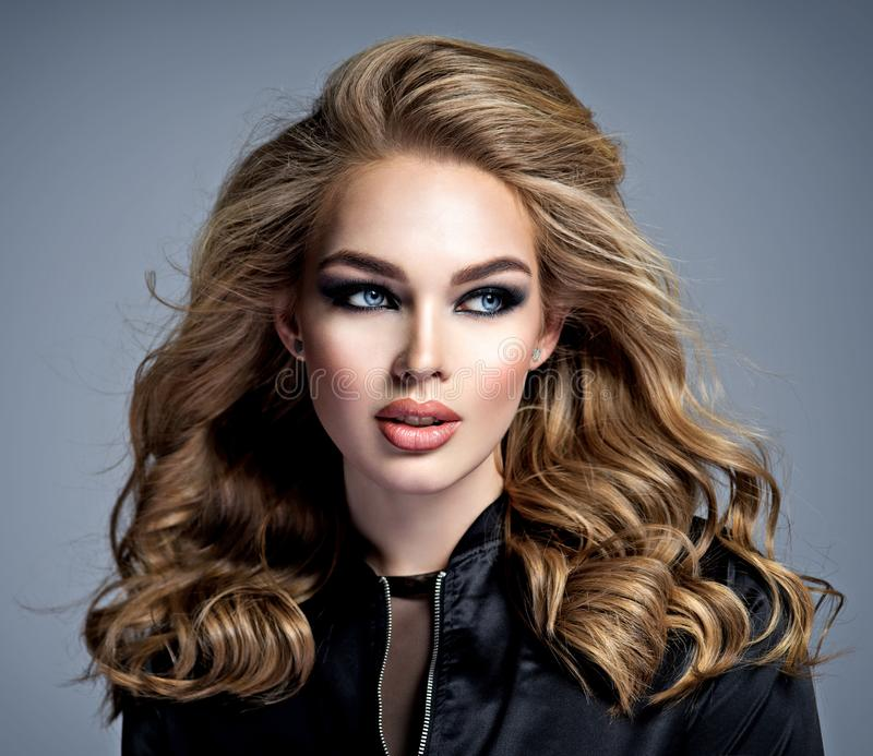 Beautiful blonde girl with  makeup in style smoky eyes stock photography